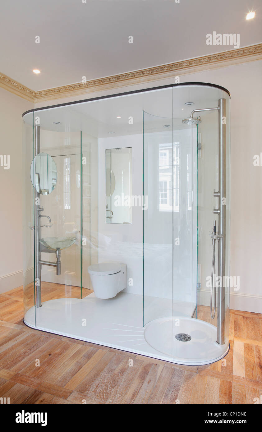Freestanding shower and toilet unit in minimalist bathroom Stock ...