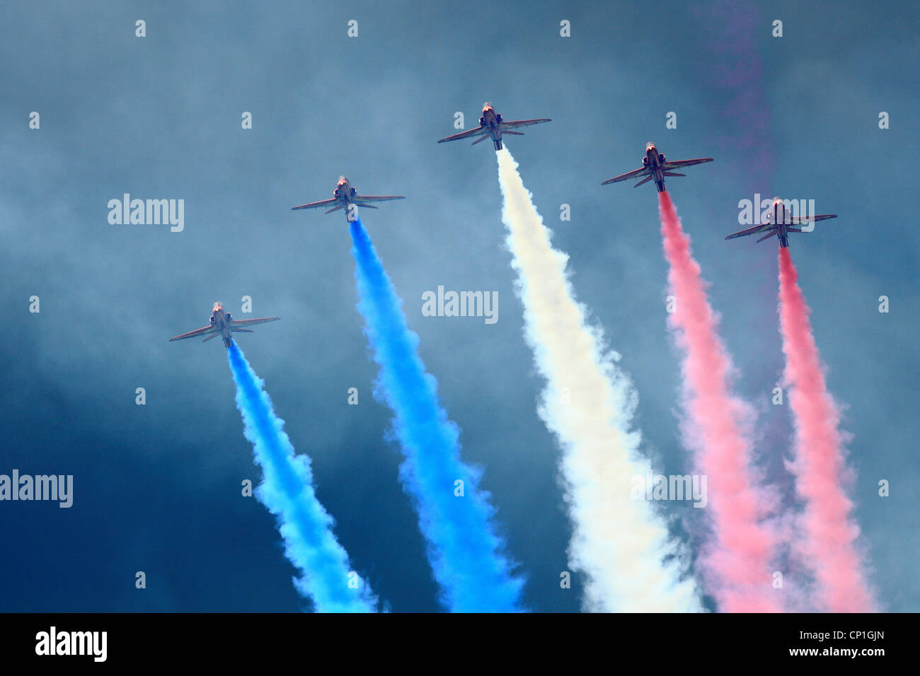 RAF Red arrows flying in formation over Glorious Goodwood - Stock Image