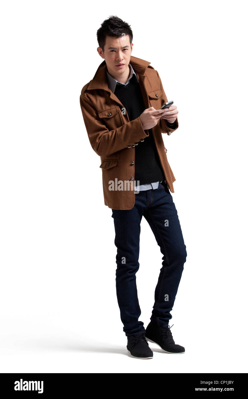 Stylish young man with moblie phone Stock Photo