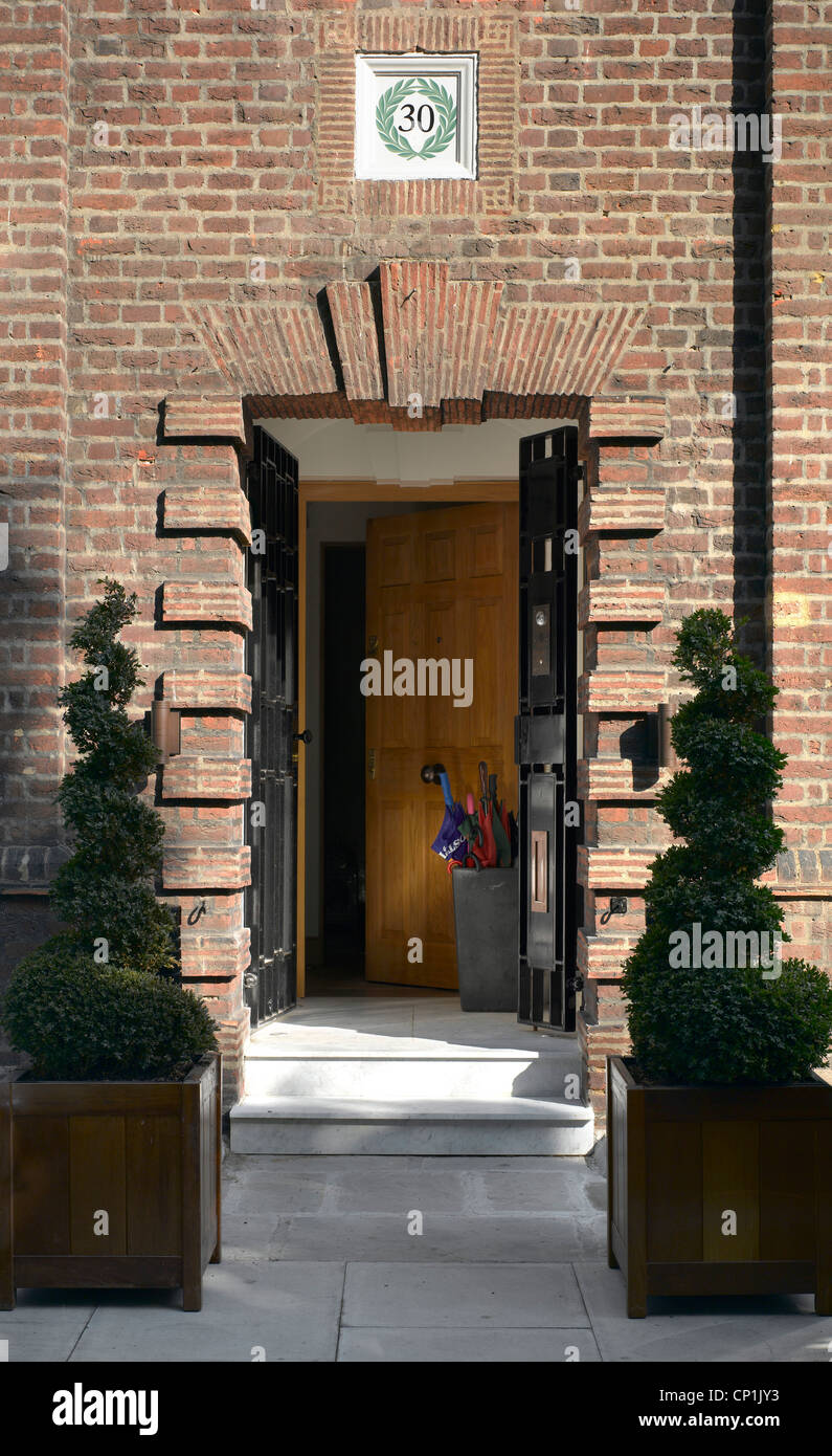 Topiary Pot Plants At Front Door Of House In Chelsea London Uk