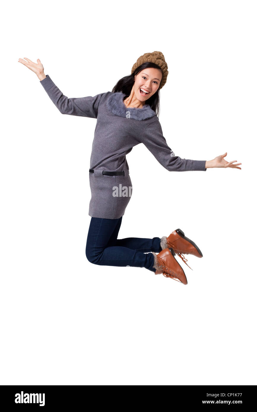 Young woman jumping in mid-air Stock Photo