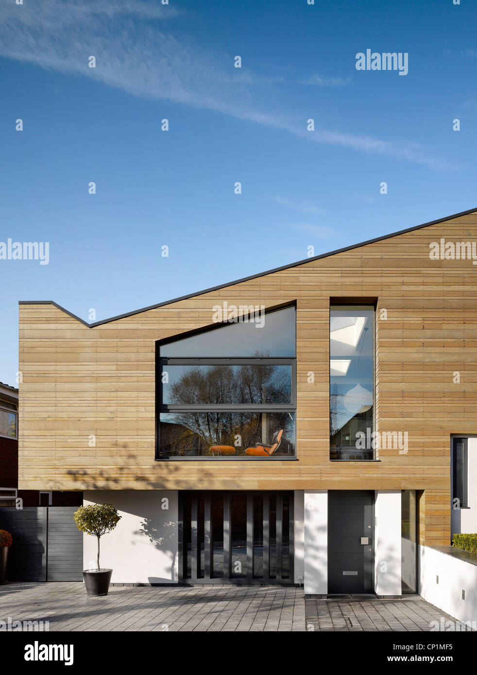 Timber Cladding On Building Exterior Of Private House In Worsley, Salford,  Greater Manchester, England, UK.