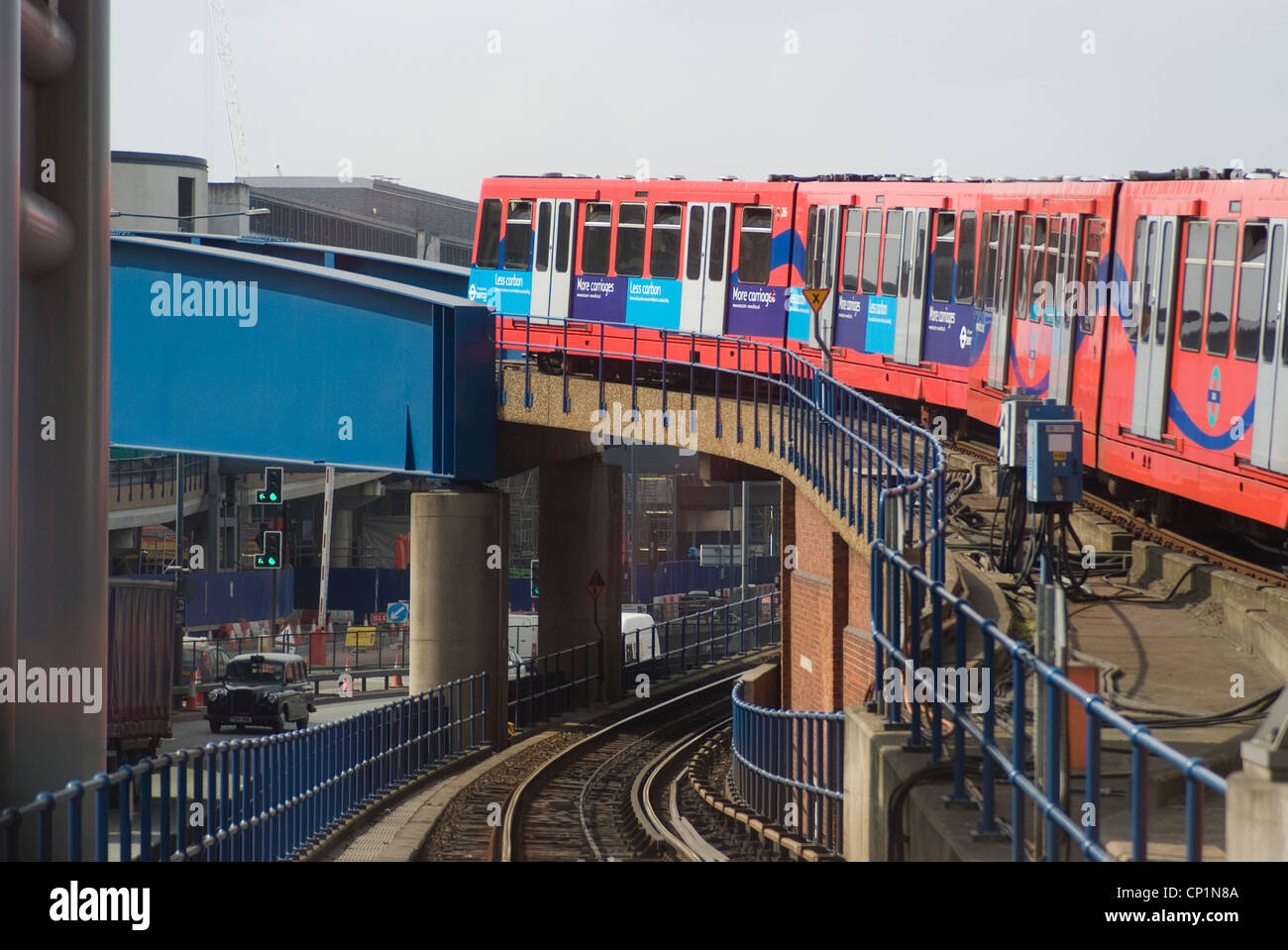 Docklands Light Railway train en route to Canary Wharf (from the east), London E14 - Stock Image