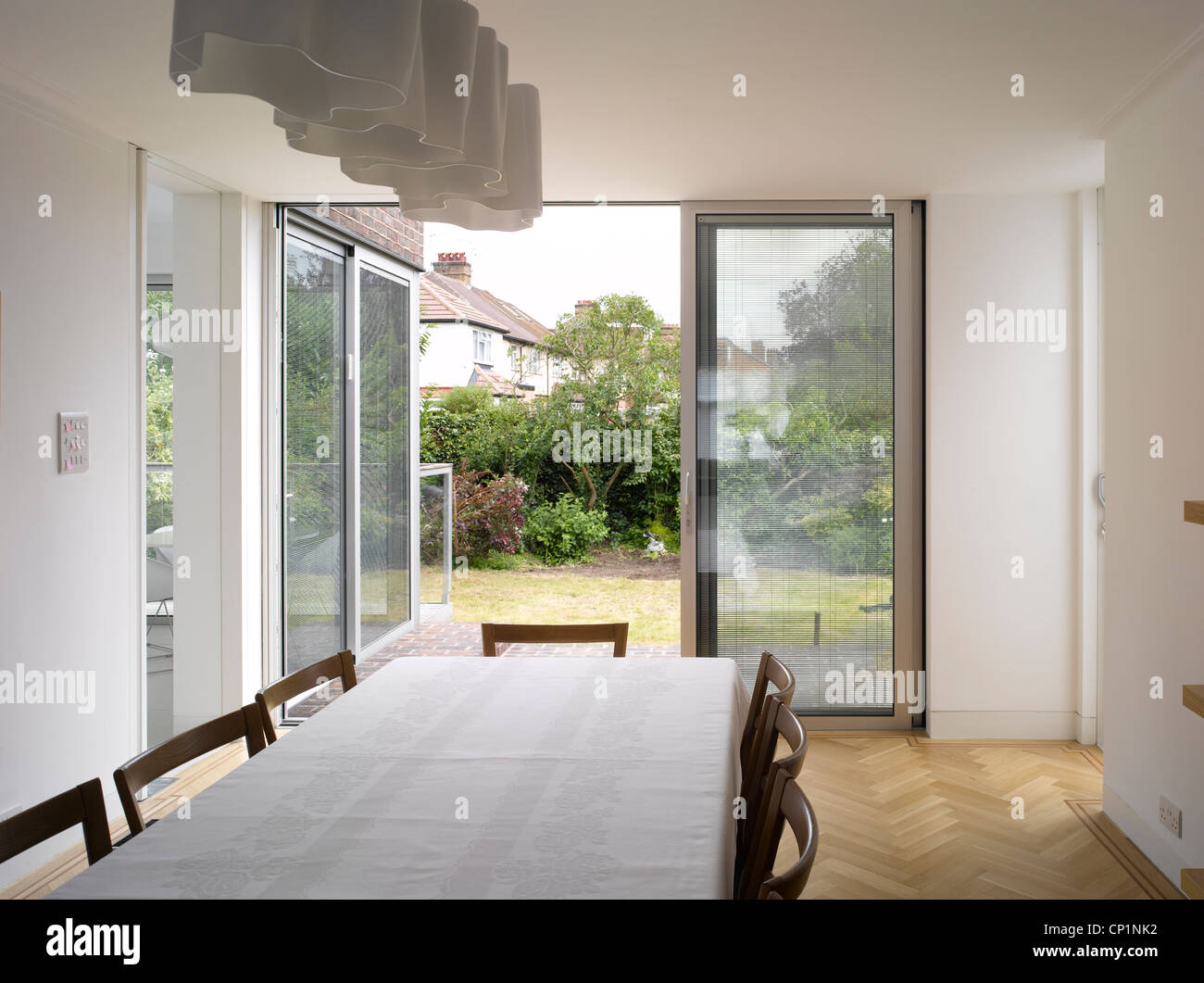 View Through Sliding Doors From Dining Room Of Edgware House Extension London UK