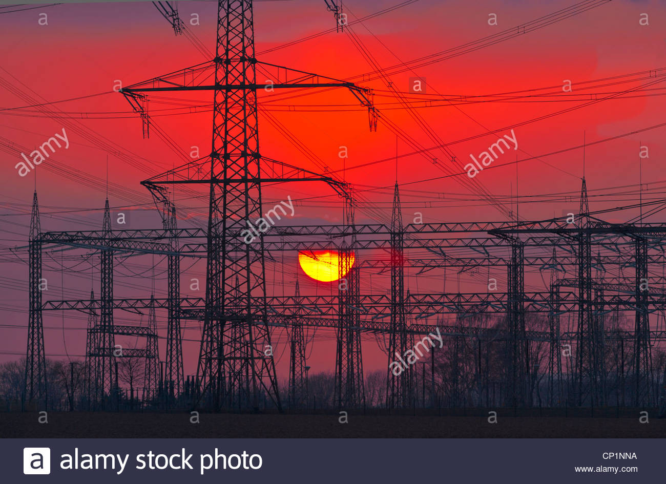 substation electricity power transformer station setting sun powerlines pylons energy supply distribution electric - Stock Image