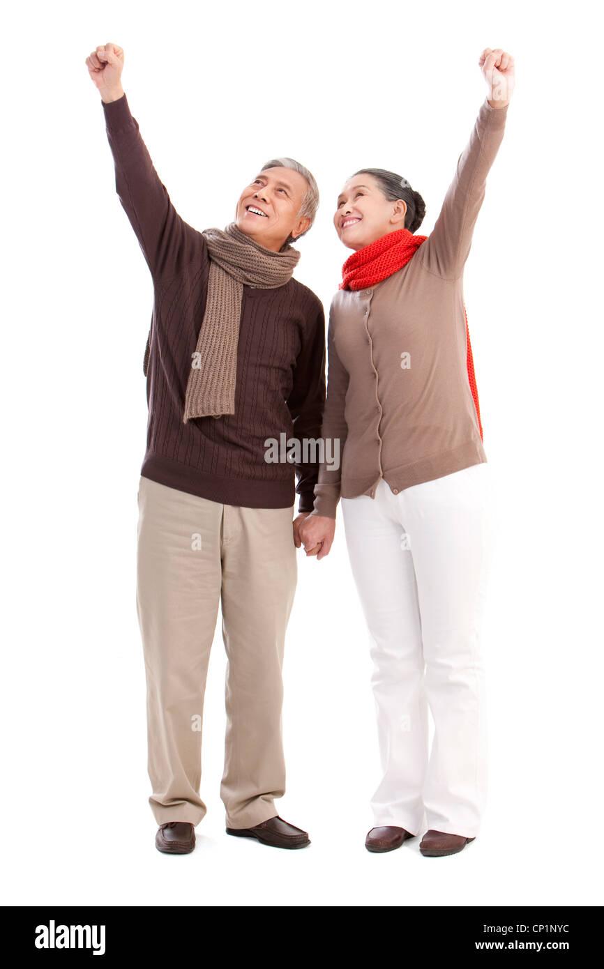 Senior couple punching the air - Stock Image