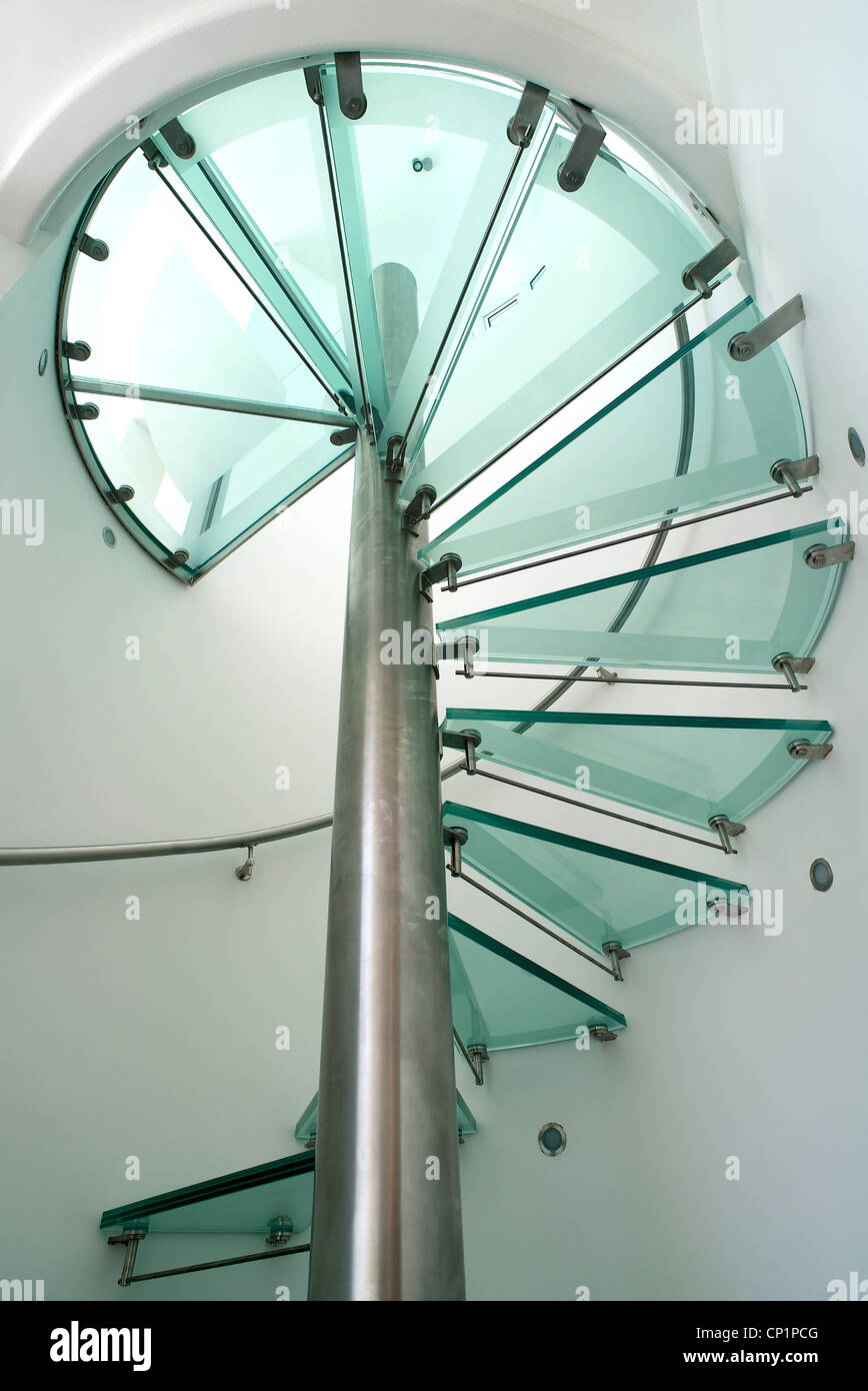 The Steel And Glass Spiral Staircase. Looking Up Through The Glass Treads.