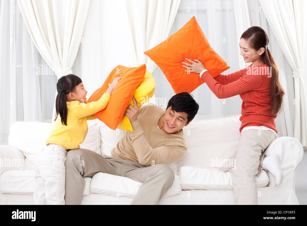 Family doing pillow fighting - Stock Image