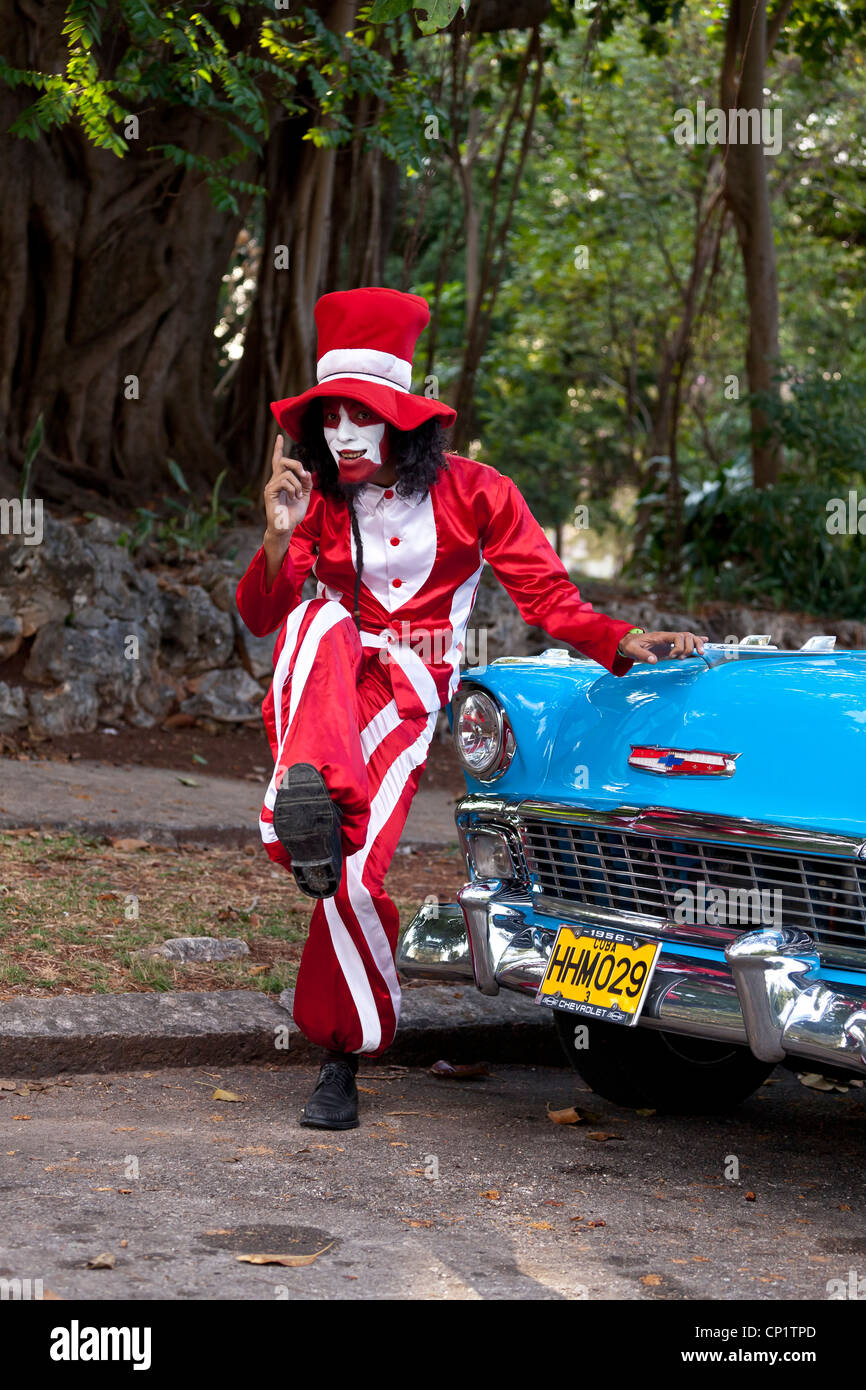A Cuban Mime strikes a pose in front of a 1955 Chevy BelAir - Stock Image