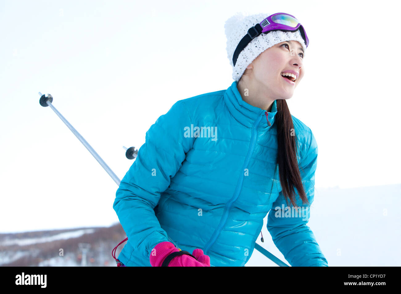 Young woman in skiing resort - Stock Image