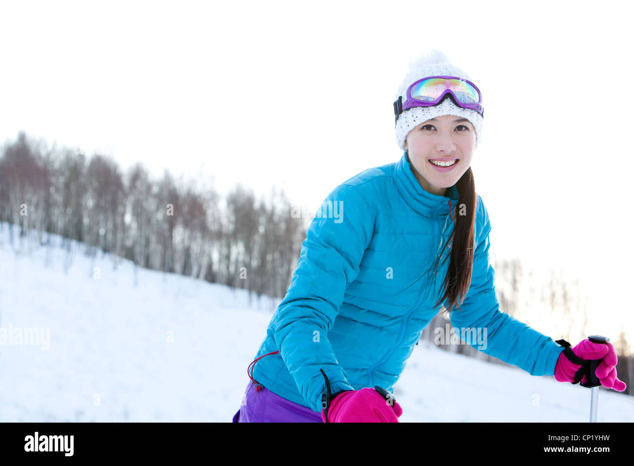 Young woman in skiing resort Stock Photo