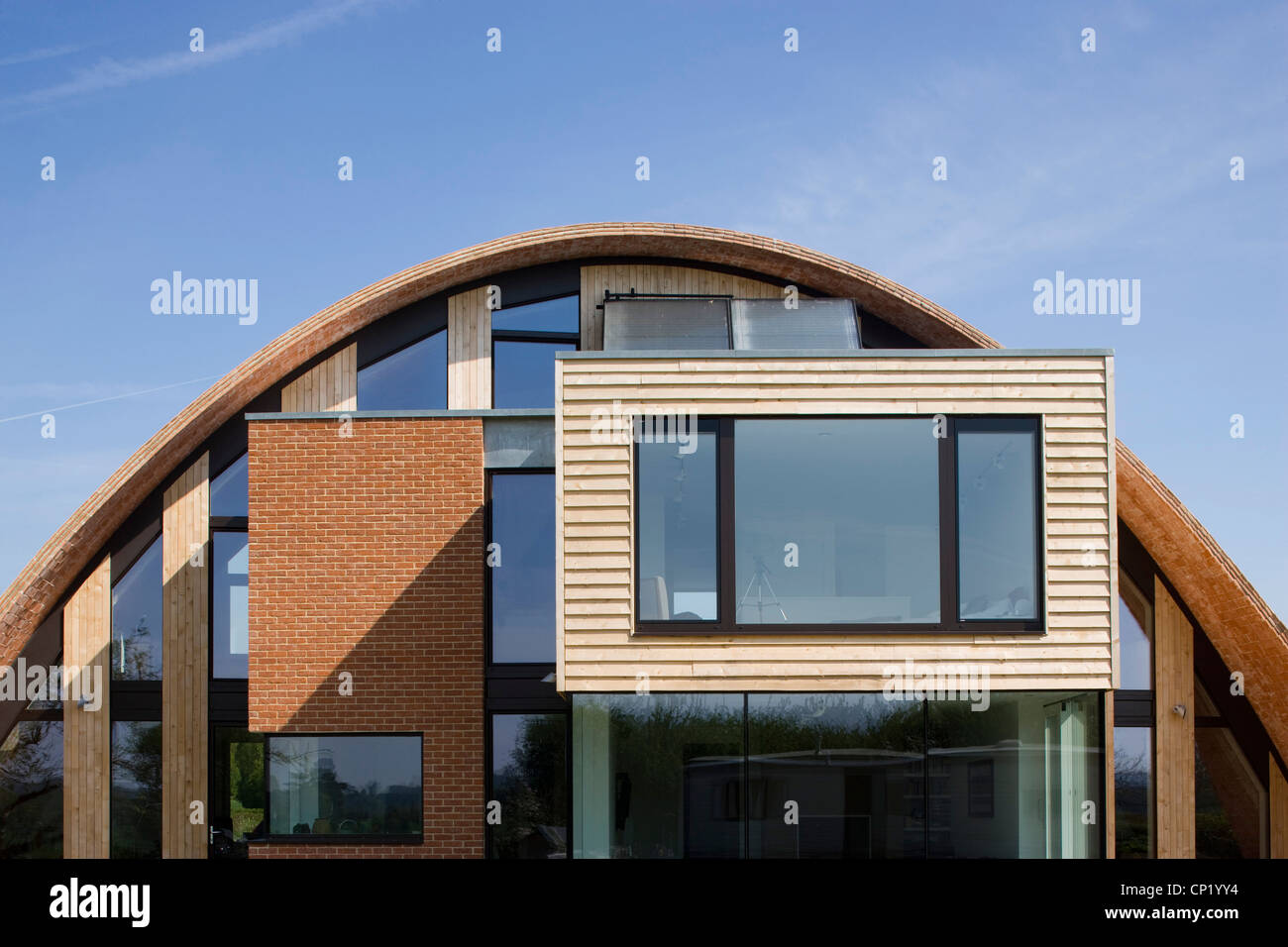 zero carbon house, Crossway, Kent, England, UK, England. Semicurcular front facade with windows - Stock Image
