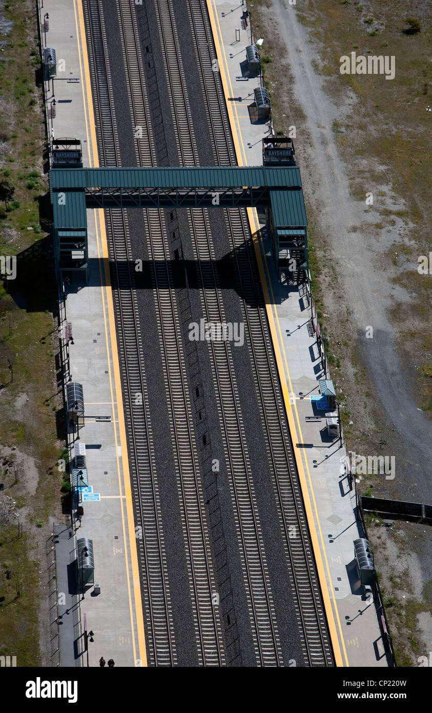aerial photograph pedestrian rail overcrossing Bayshore CalTrain stop northern California - Stock Image