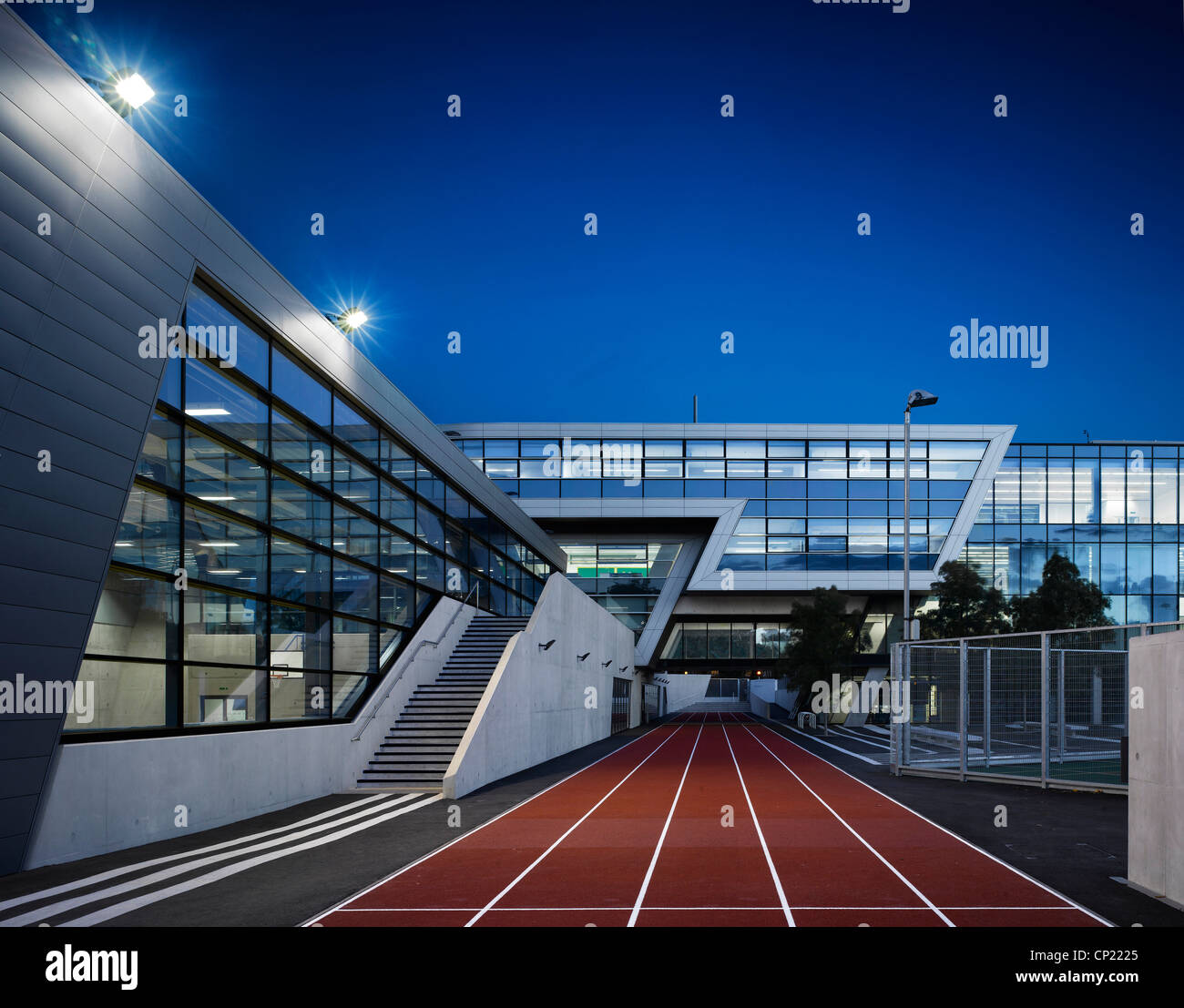 Night-time Exterior of athletics running track at Evelyn Grace Academy, Brixton, South London Stock Photo