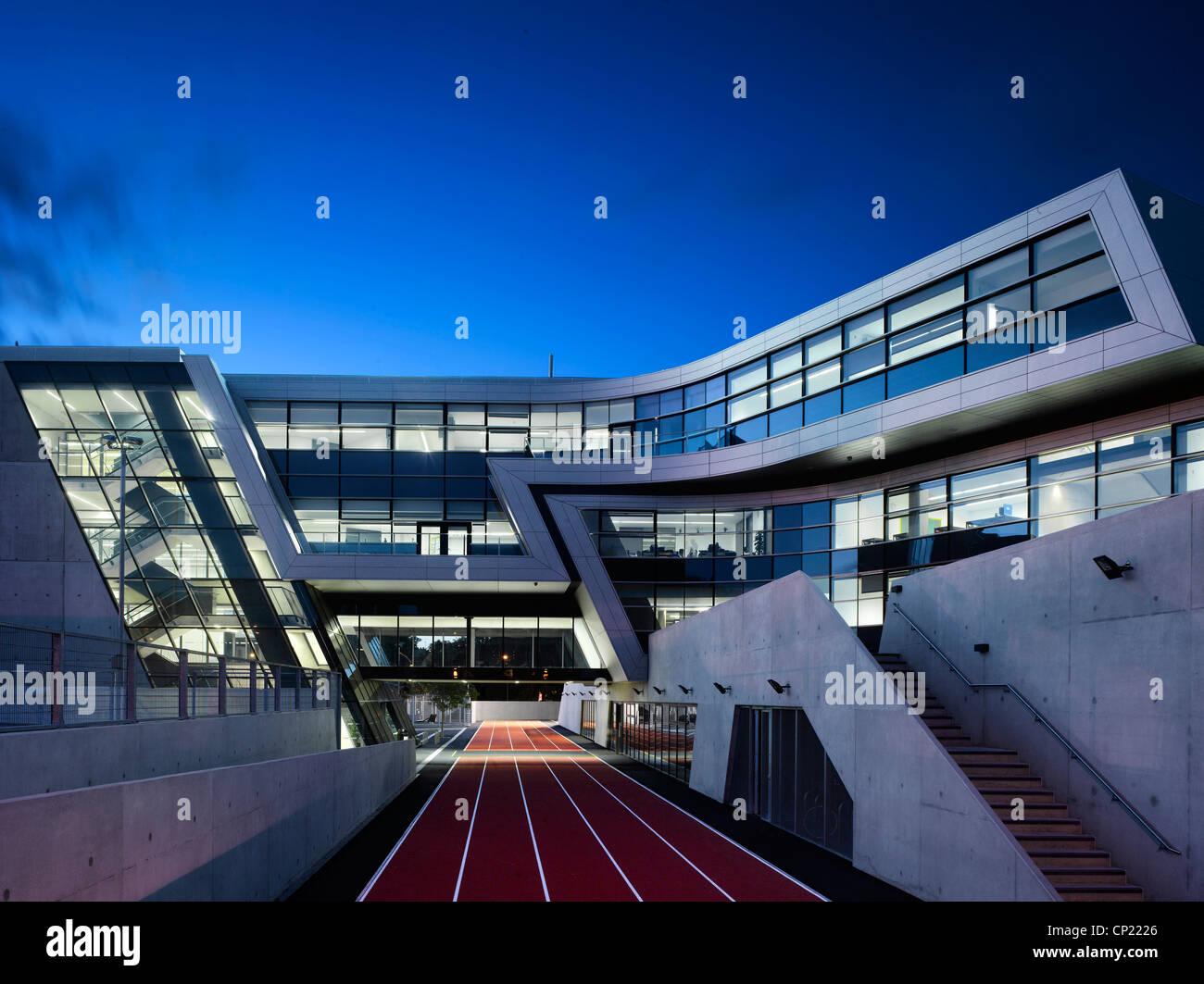 Night Exterior of Evelyn Grace Academy, a school by Zaha Hadid Stock Photo