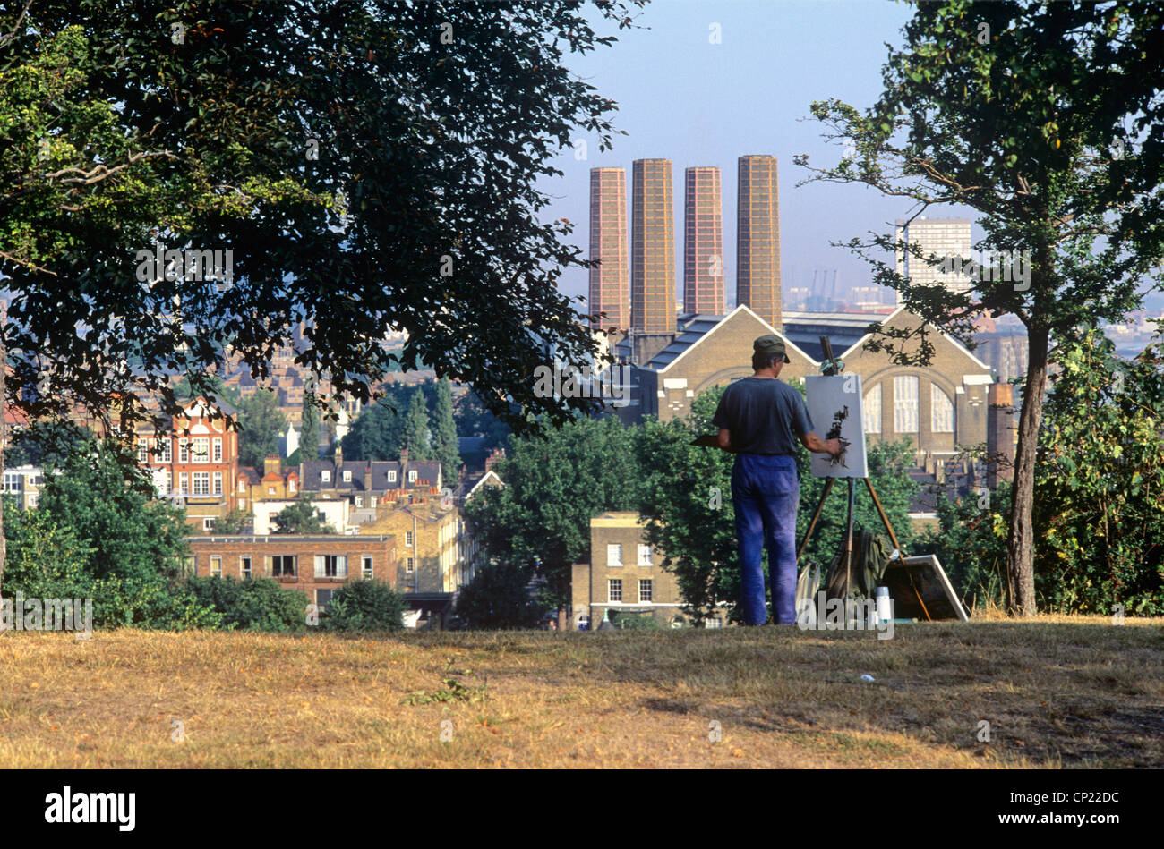 Great Britain, London, painter in Greenwich Park with view on powerplant - Stock Image
