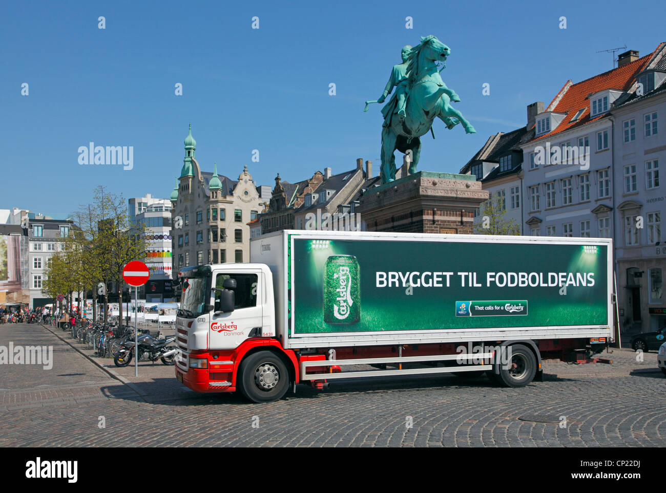 Carlsberg delivery lorry in front of the Absalon equestrian statue close to Højbro Plads in central Copenhagen, - Stock Image