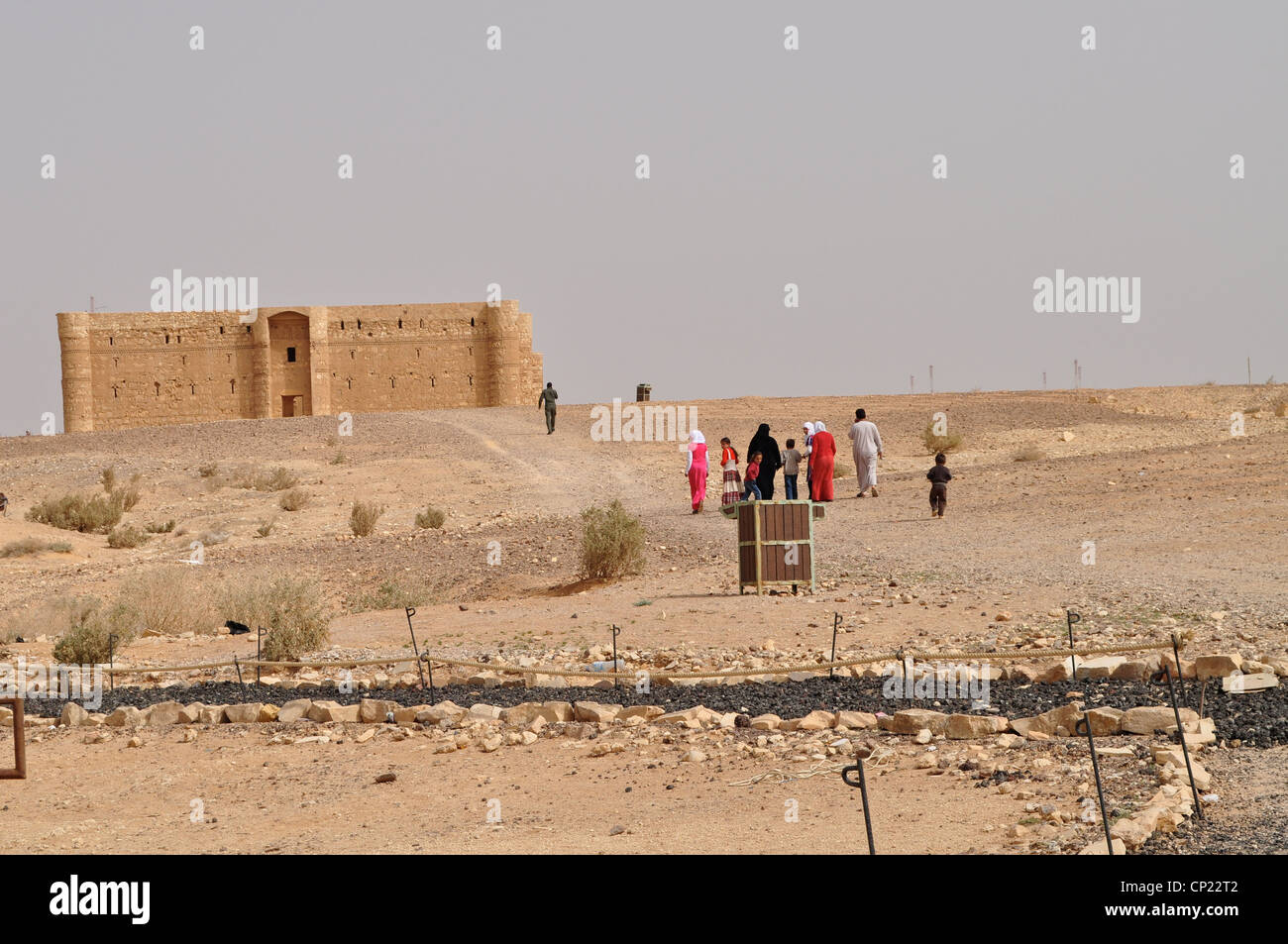 Muslim families visiting Qasr Al Kharaneh, or Kharana, Jordanian desert castle, 37 miles east of Amman, early 8th Stock Photo