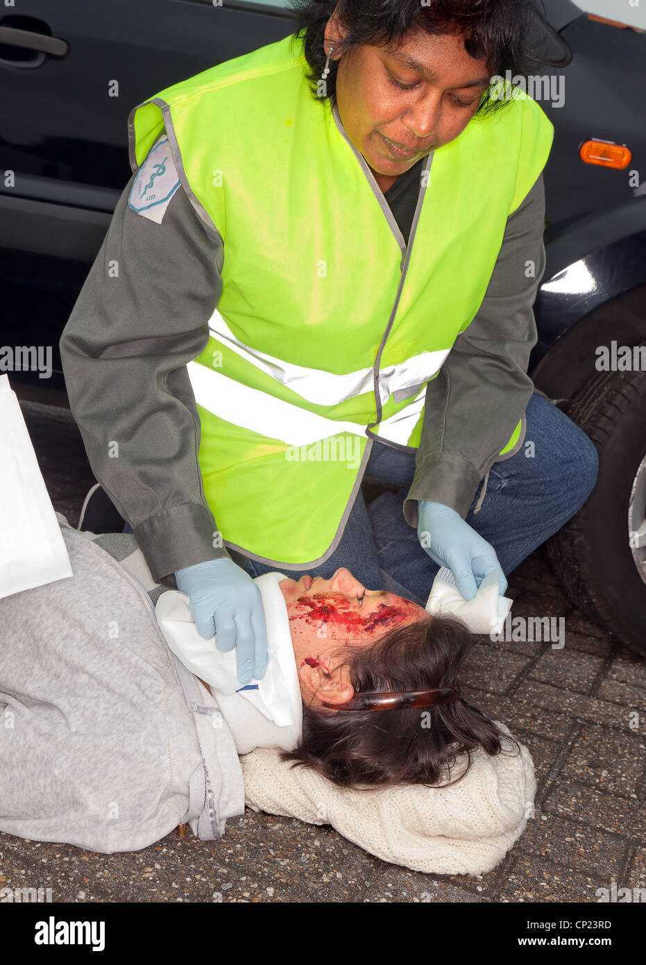 Female car crash victim with whiplash neck brace (the sleeve badges were replaced by a non existing logo) - Stock Image