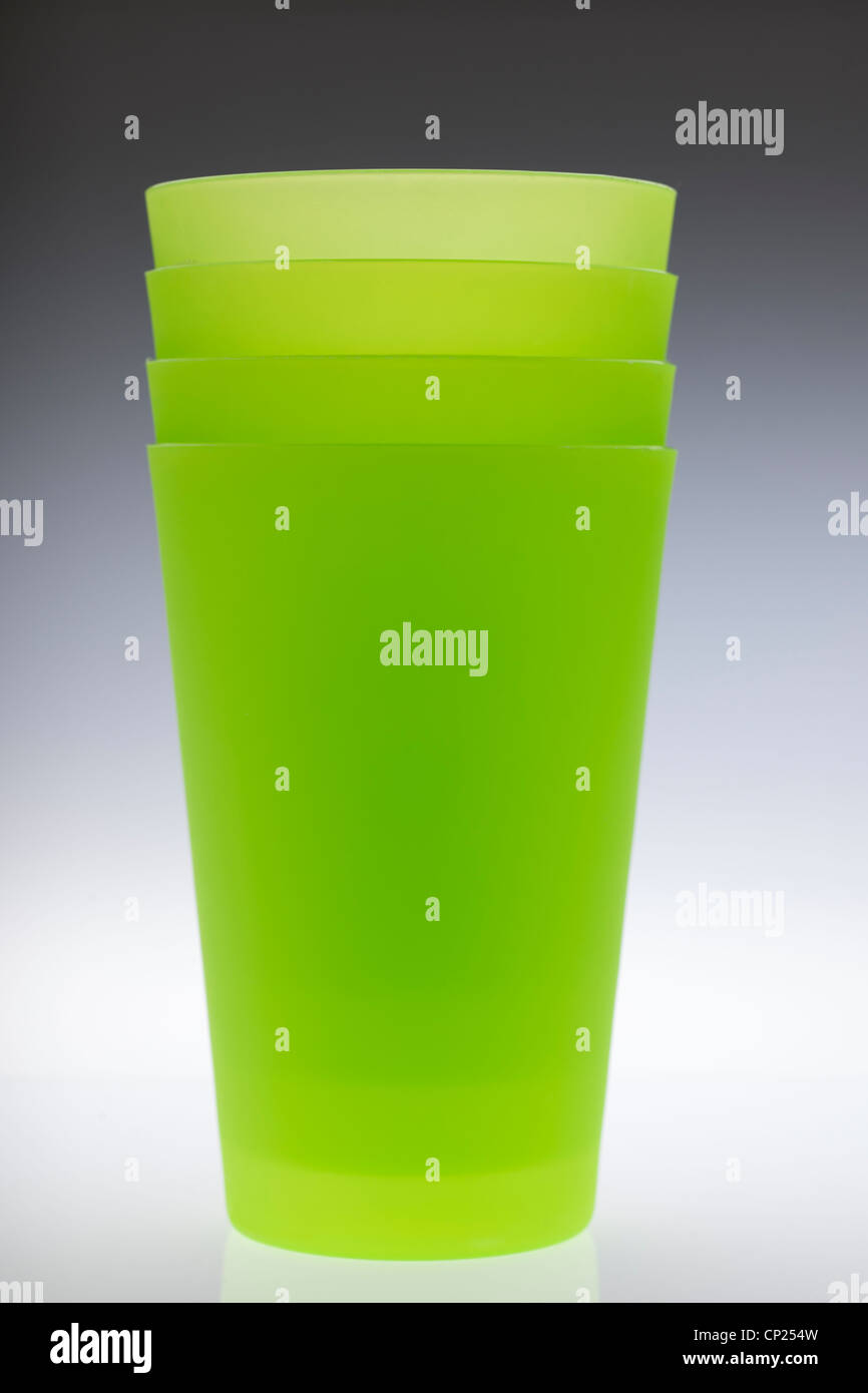 Four stacked green plastic beakers Stock Photo