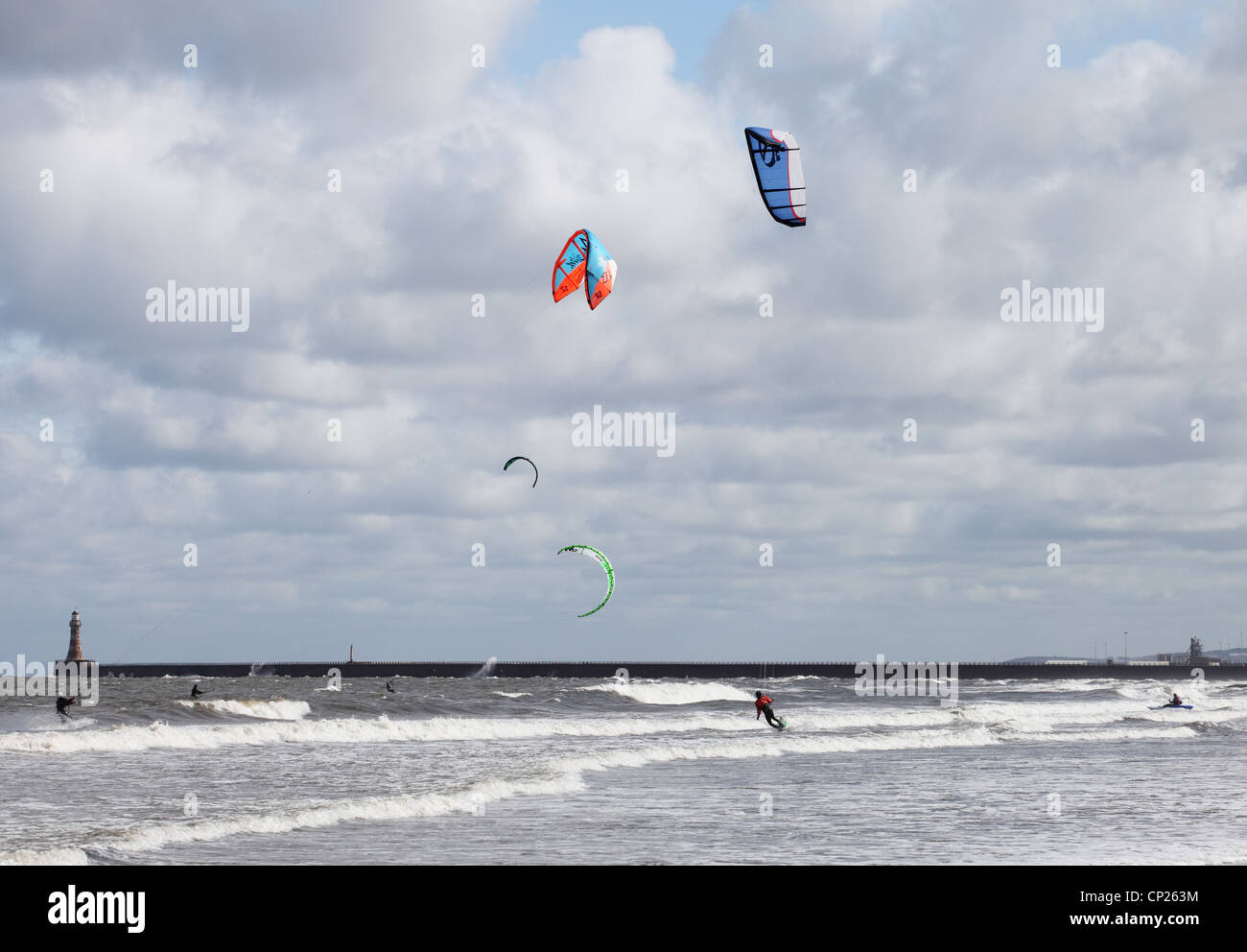 Kitesurfers in the north sea at Roker, Sunderland, north east England, UK - Stock Image