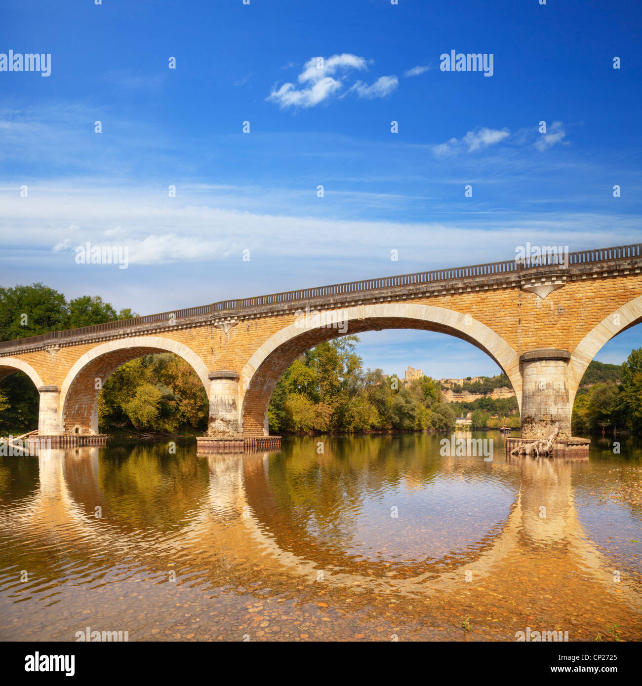 Beautiful old bridge on the River Dordogne at Beynac, Limousin, France, on a summer afternoon. - Stock Image