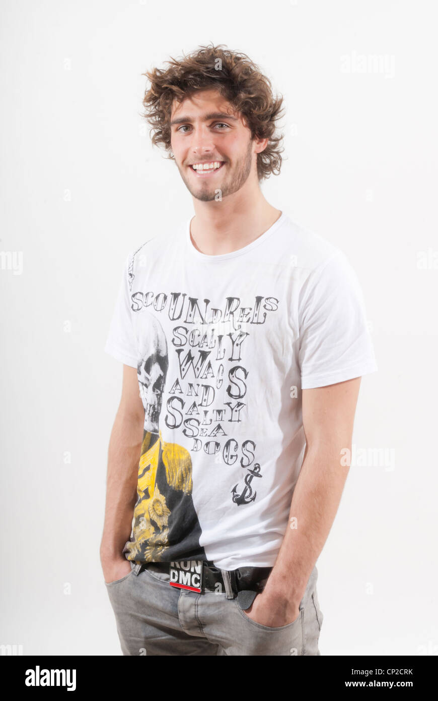 Young adult Caucasian male model in casual pose wearing t