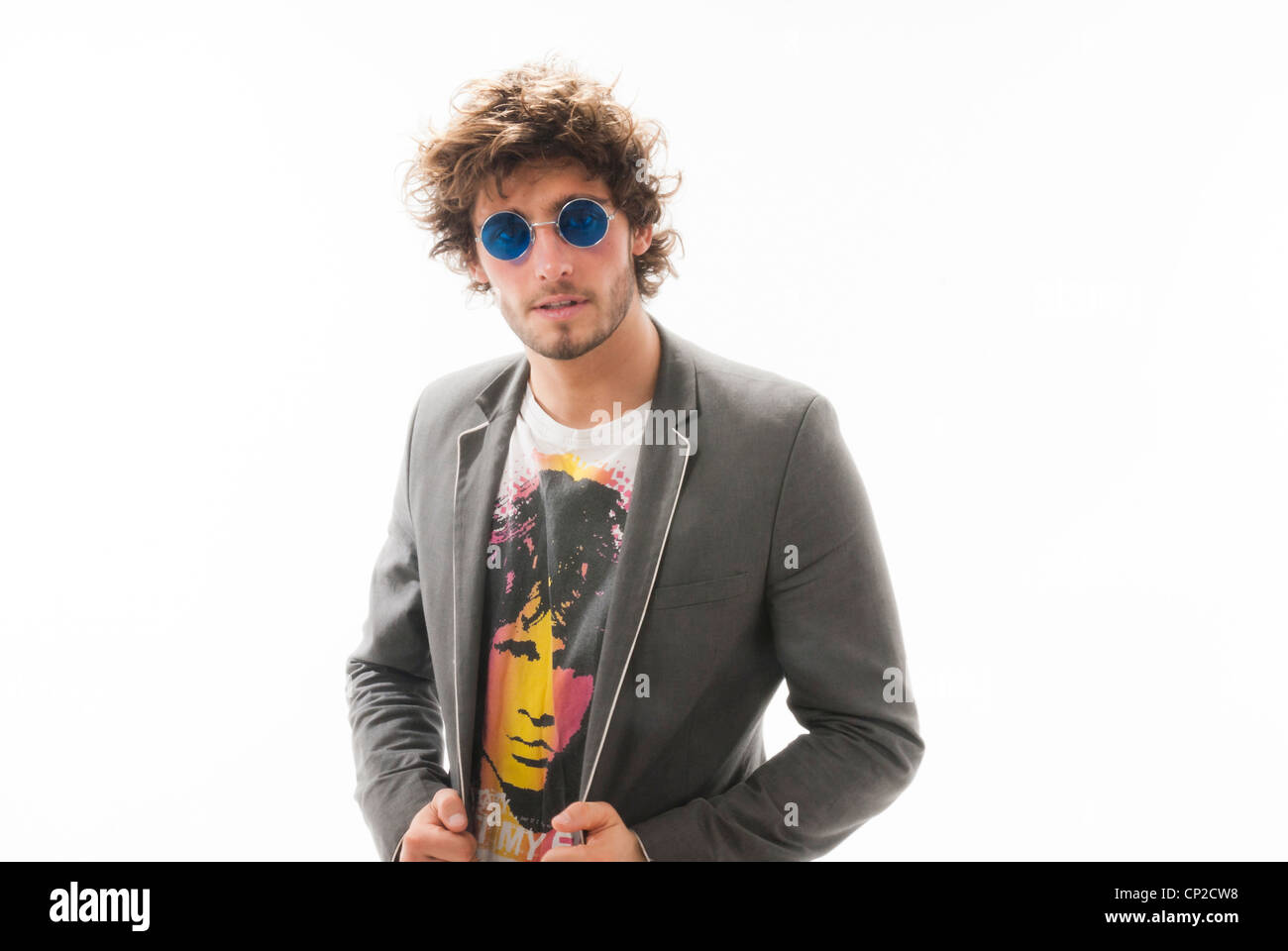 crazy hair male model with blue john lennon style glasses wearing stock photo 47997188 alamy. Black Bedroom Furniture Sets. Home Design Ideas