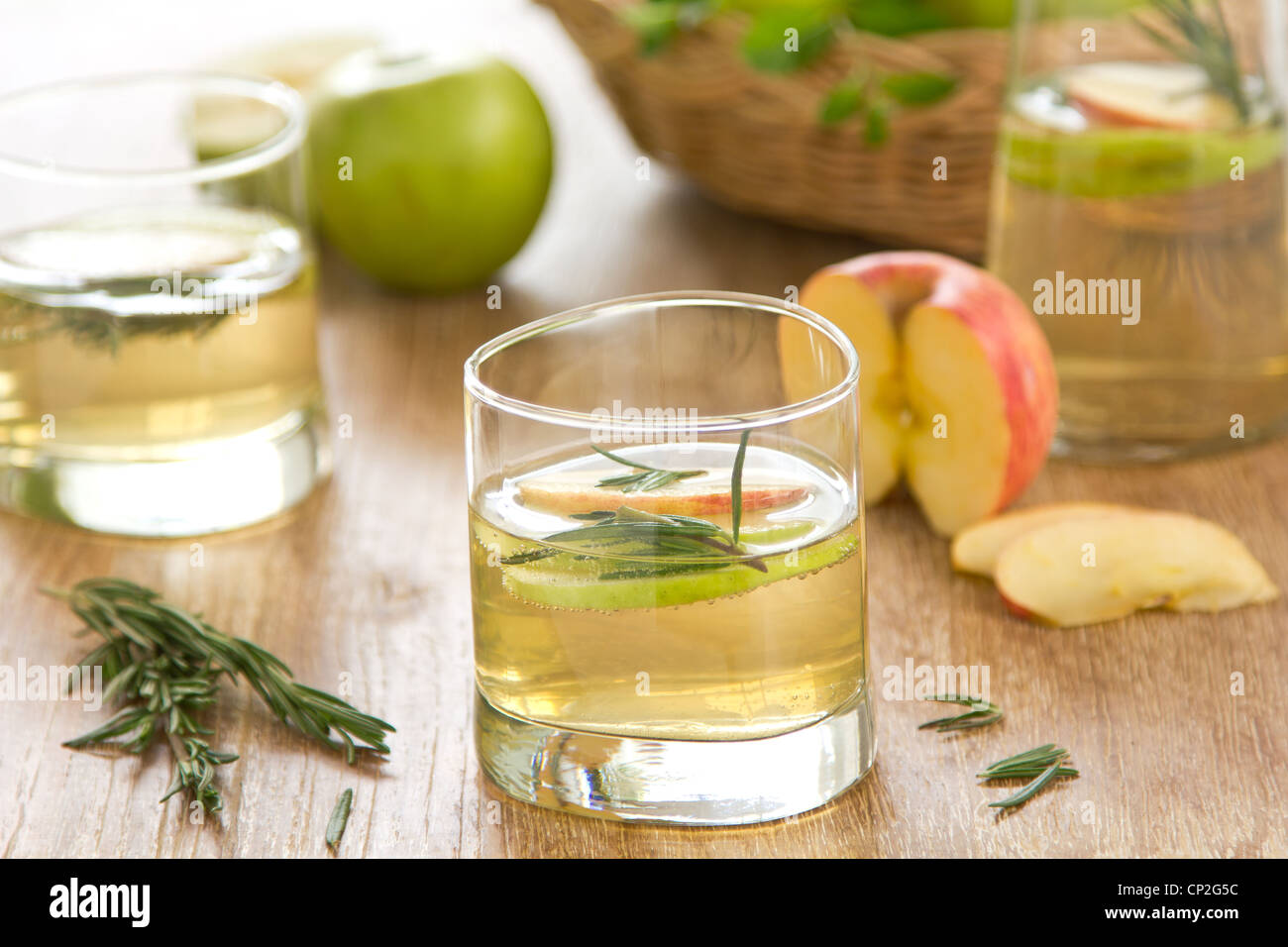 Apple juice with rosemary - Stock Image