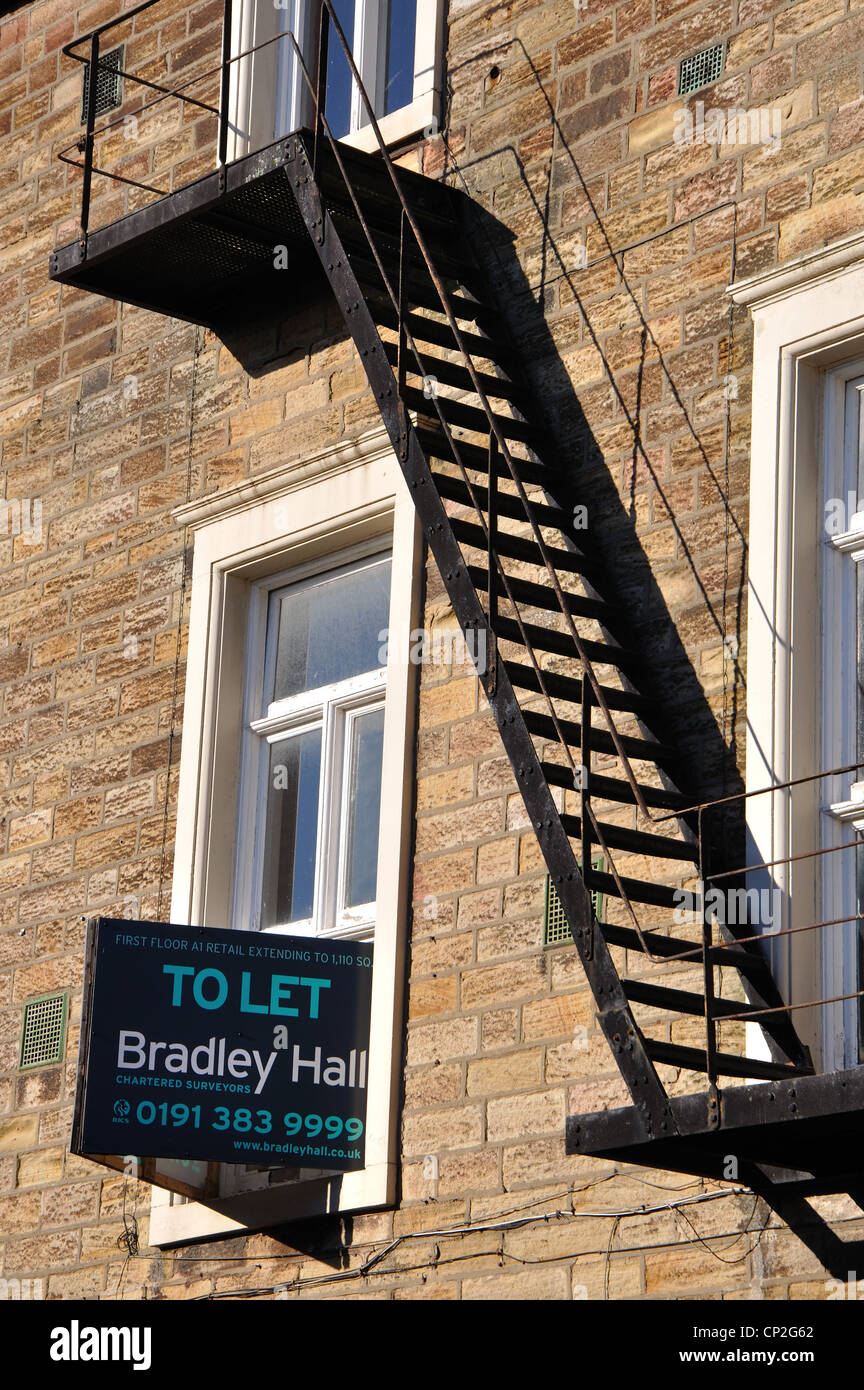 fire escape and To Let sign, Consett, County Durham, UK - Stock Image