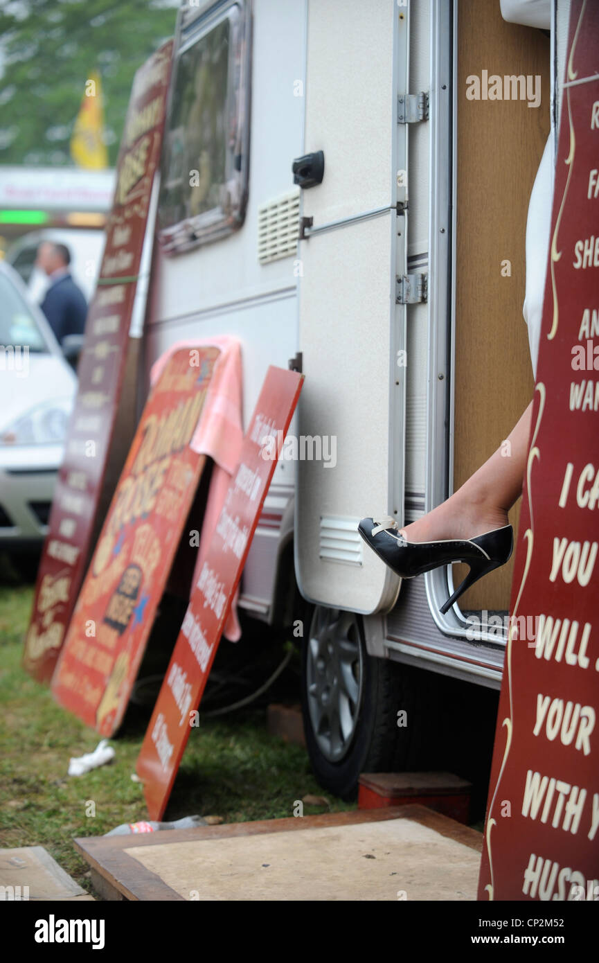 A ladies heel appears from the door of Fortune teller Romany Rose's caravan at the Stow-on-the-Wold horse fair - Stock Image