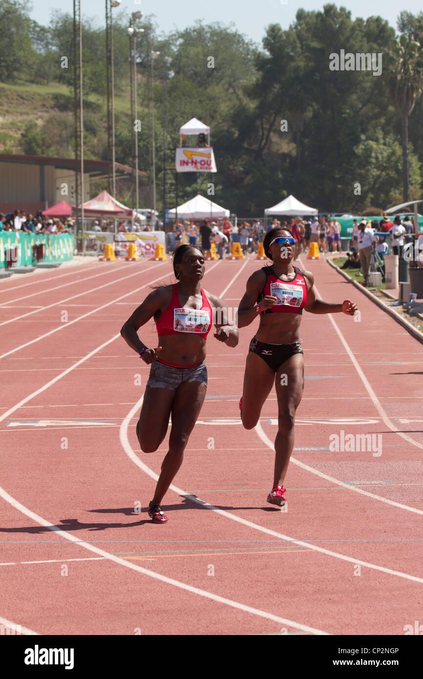 Chauntae Bayne (left) Margaret Adeoye (right) Mt Sac relays 2012, Walnut, California, USA - Stock Image