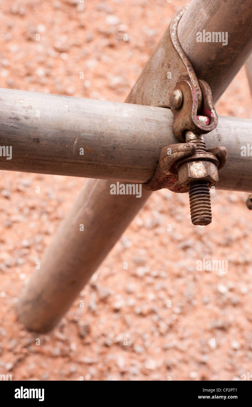 Scaffold connectors joining scaffolding poles together. - Stock Image