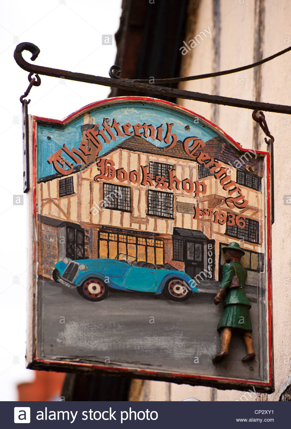 Hanging sign outside Fifteenth Century Book shop in Lewes High Street, East Sussex. - Stock Image
