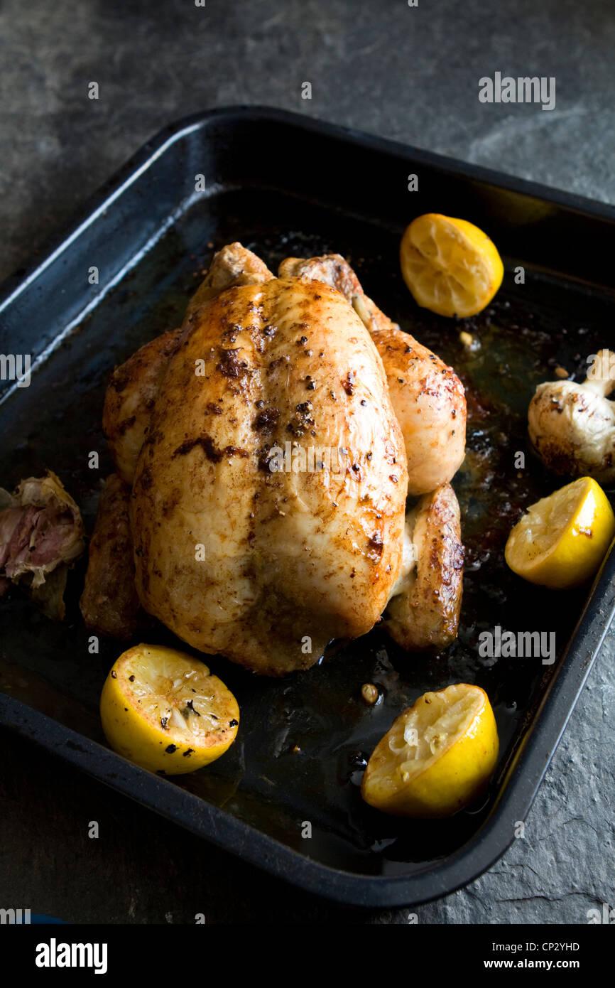 Roast chicken with lemon and garlic - Stock Image