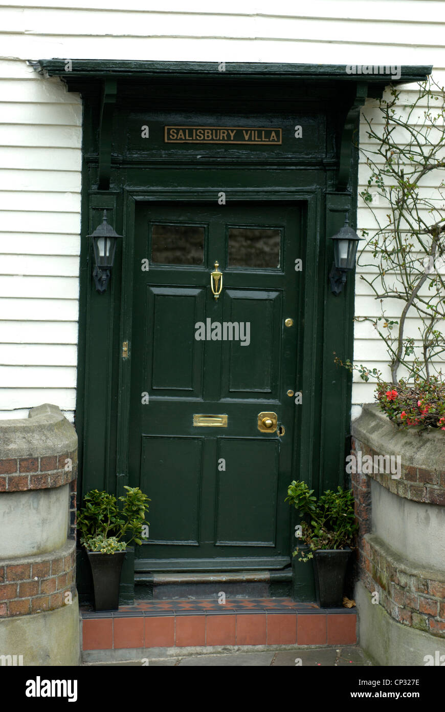 Quaint wonky door and frame in Rochester a city closely connected with the writings of Charles Dickens - Stock Image