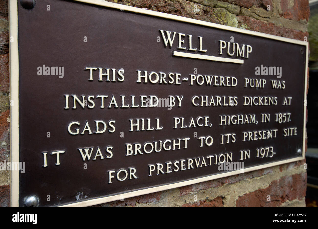 Cast Iron sign for a Well Pump in Rochester.  Telling the brief story of a Horse-Powered pump installed by Charles - Stock Image