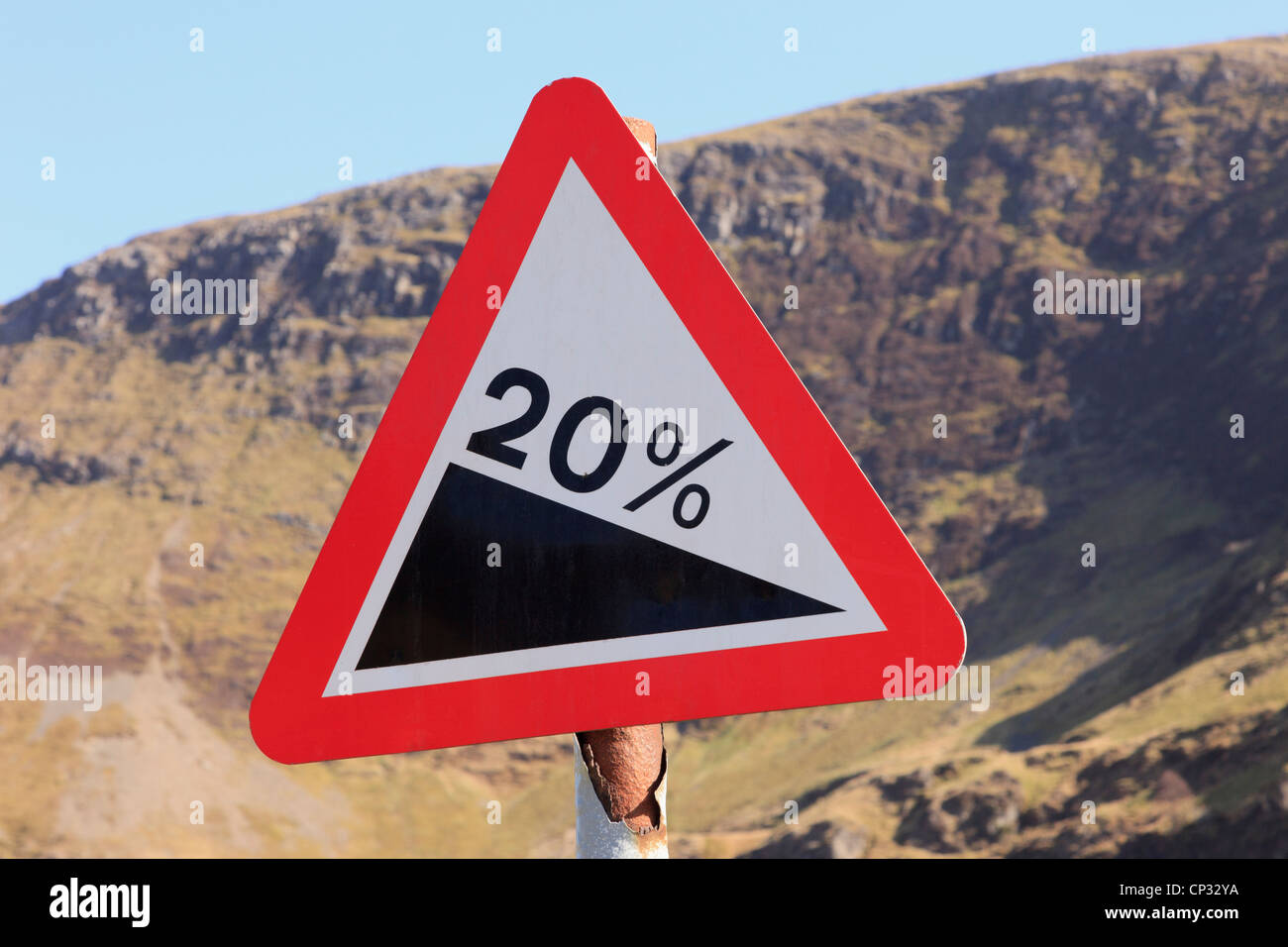 Red triangular steep slope 20% gradient warning sign on a mountain road in the mountains. Newlands Pass, Cumbria, - Stock Image