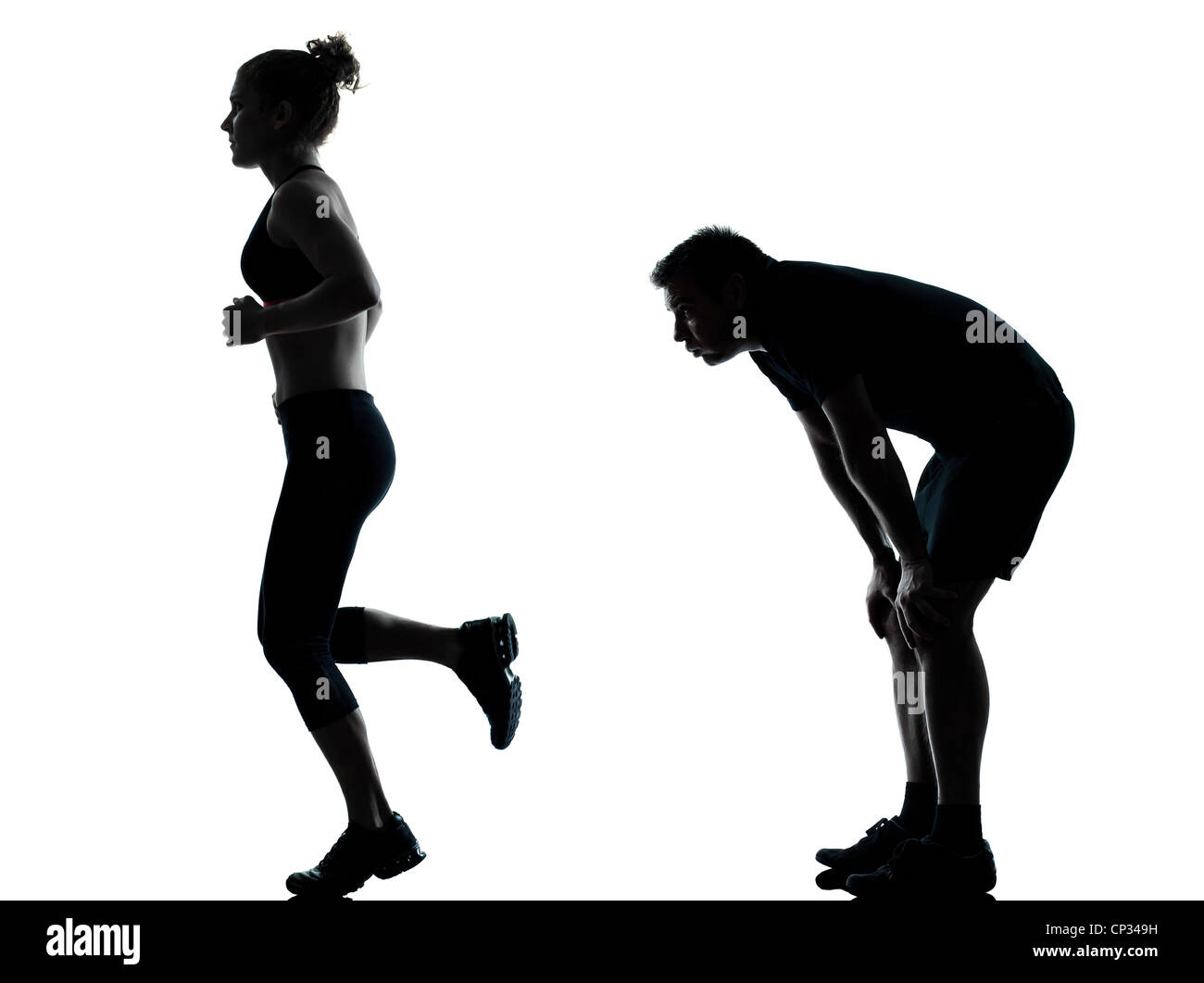 one couple man woman exercising workout aerobic fitness posture full length silhouette on studio isolated on white - Stock Image