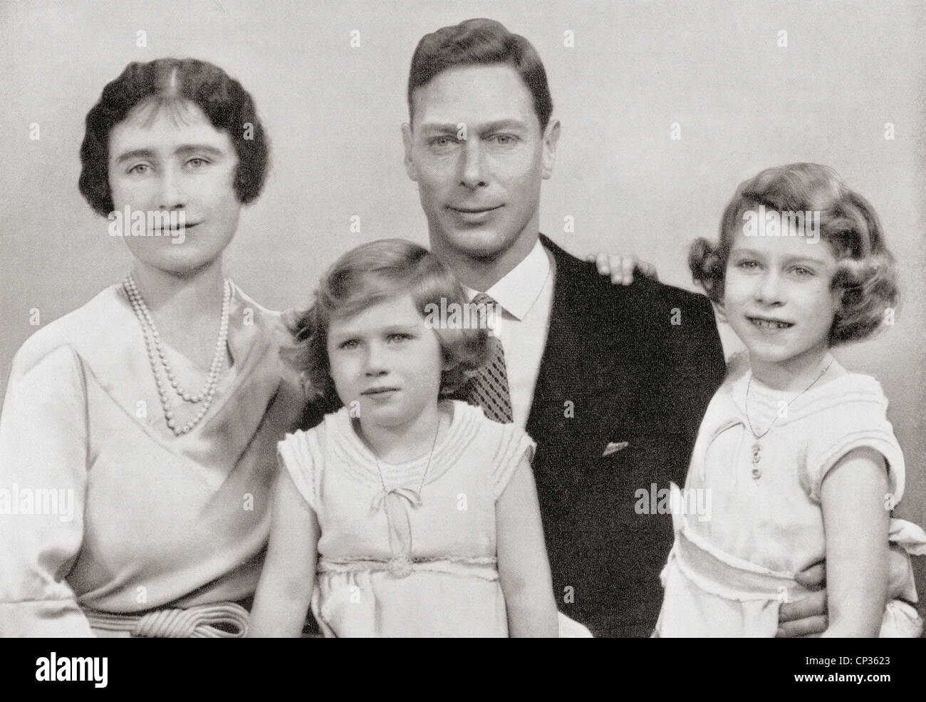 King George VI with his wife Queen Elizabeth and daughters Margaret and Elizabeth, later to reign as Queen Elizabeth II Stock Photo