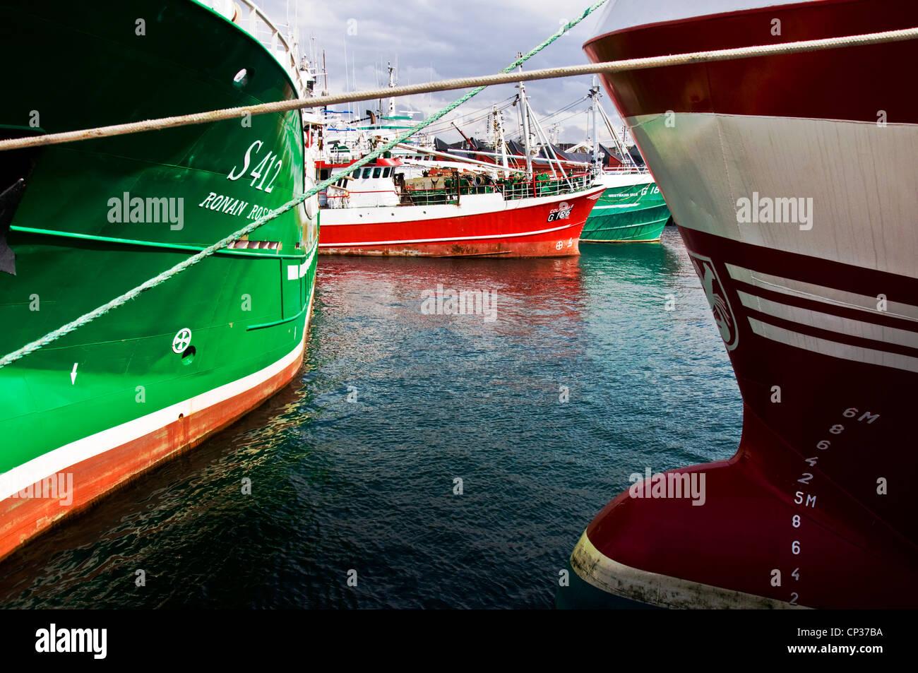 Fishing trawlers in harbour - Stock Image