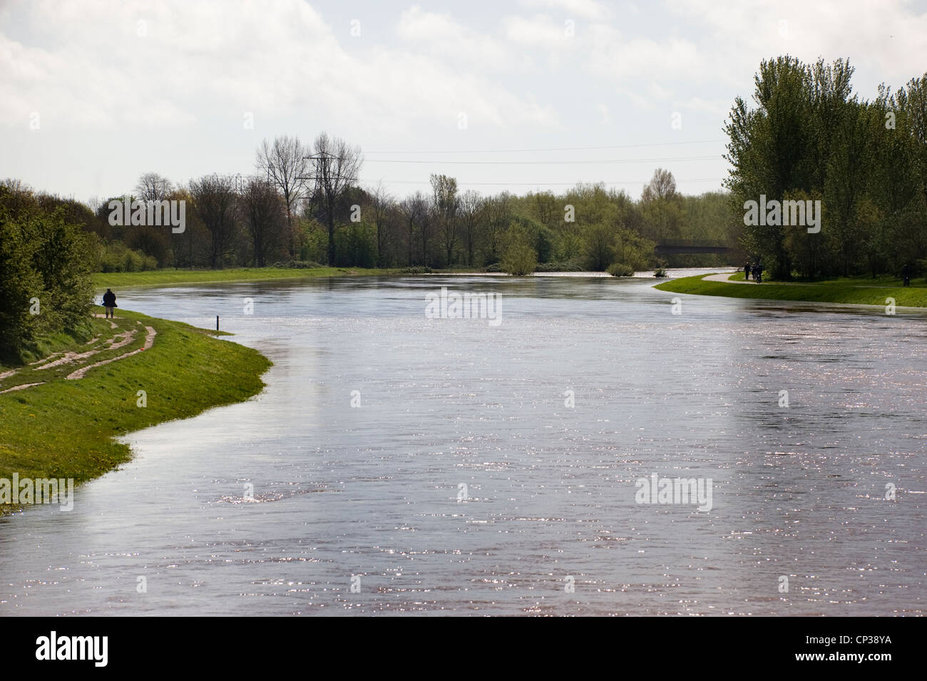 The River Exe overflowing into Exeter's flood relief and breaking the banks of the Quay following heavy rain. - Stock Image