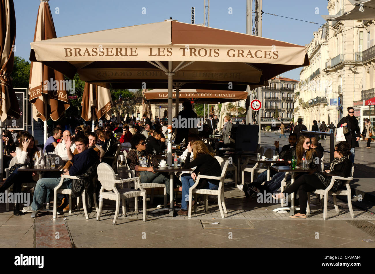 Outdoor cafe, brasserie in the Place de la Comedie in the centre of Montpellier, southern France. - Stock Image