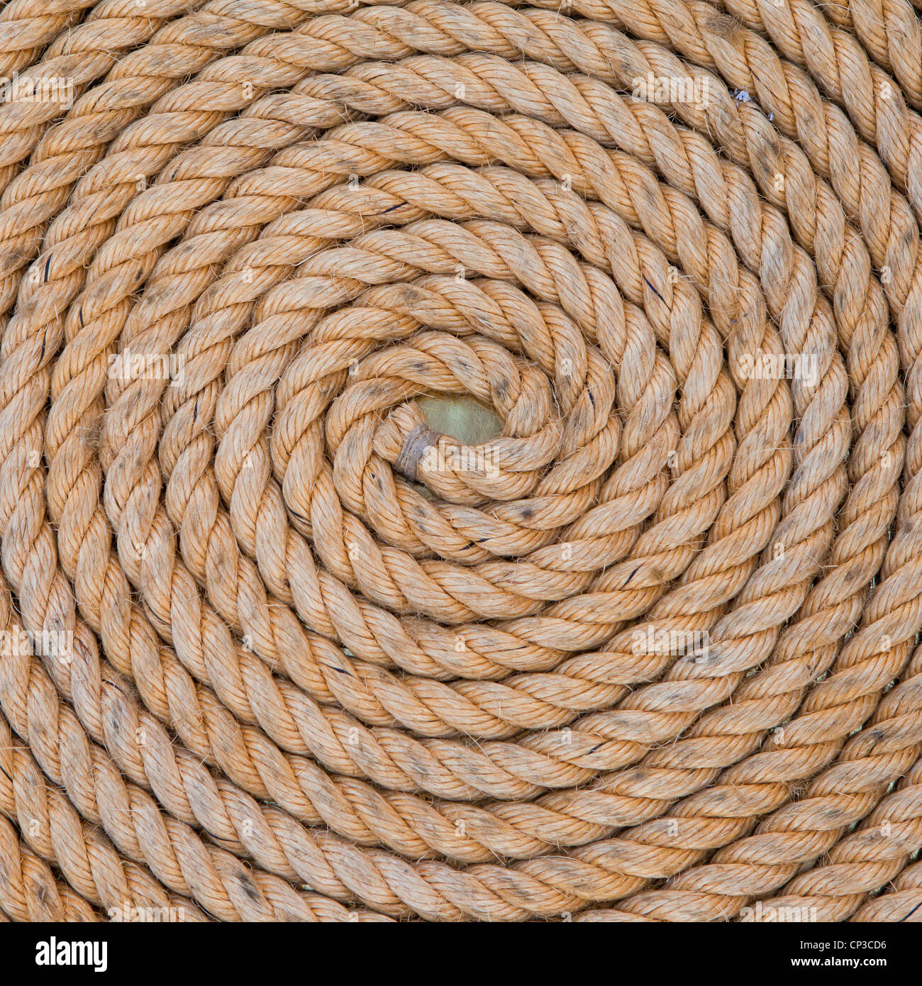 Old rope on the deck - Stock Image