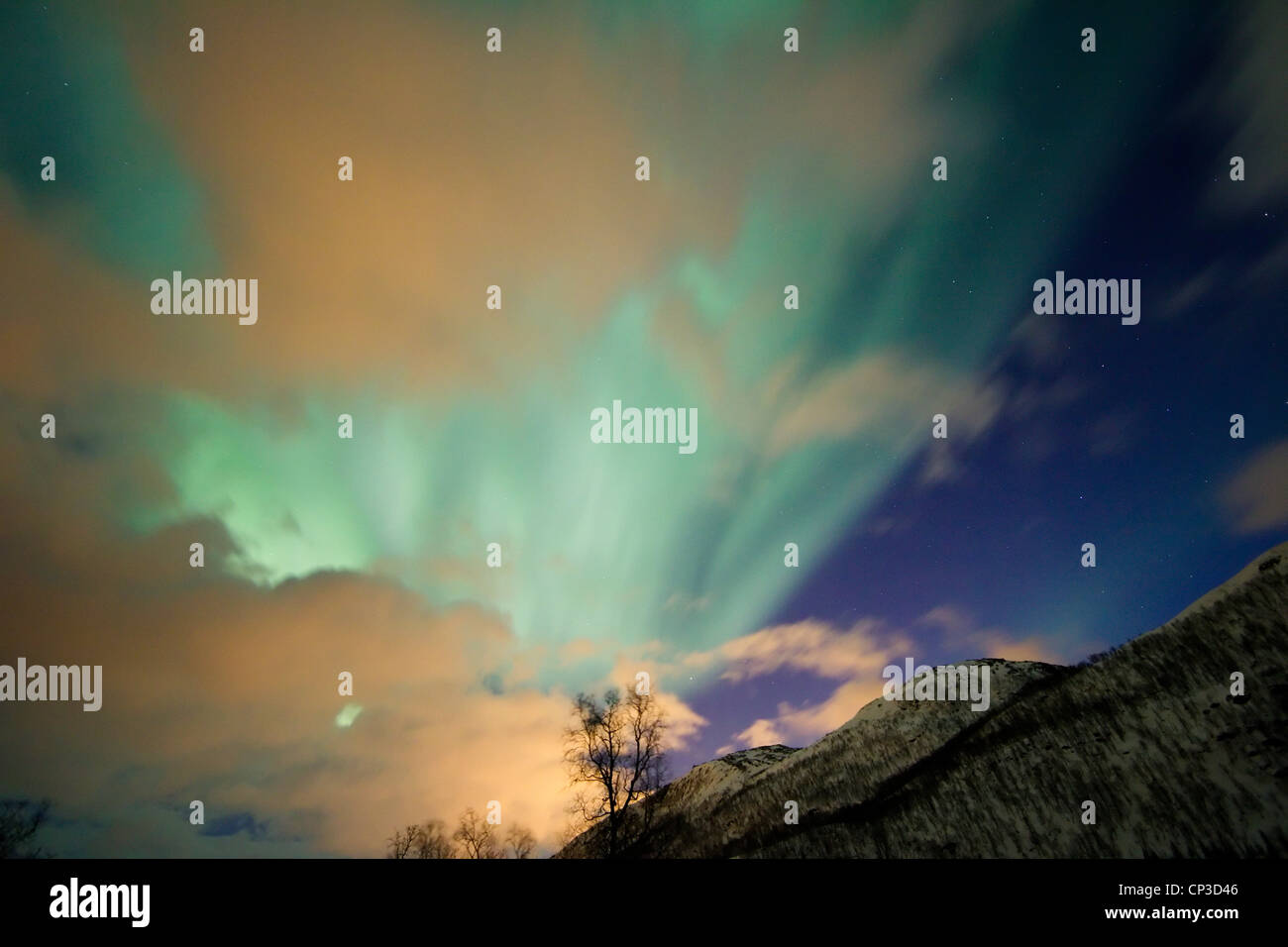 Aurora borealis or northern lights moving across night sky within the Arctic Circle Tromso Troms  region norway - Stock Image