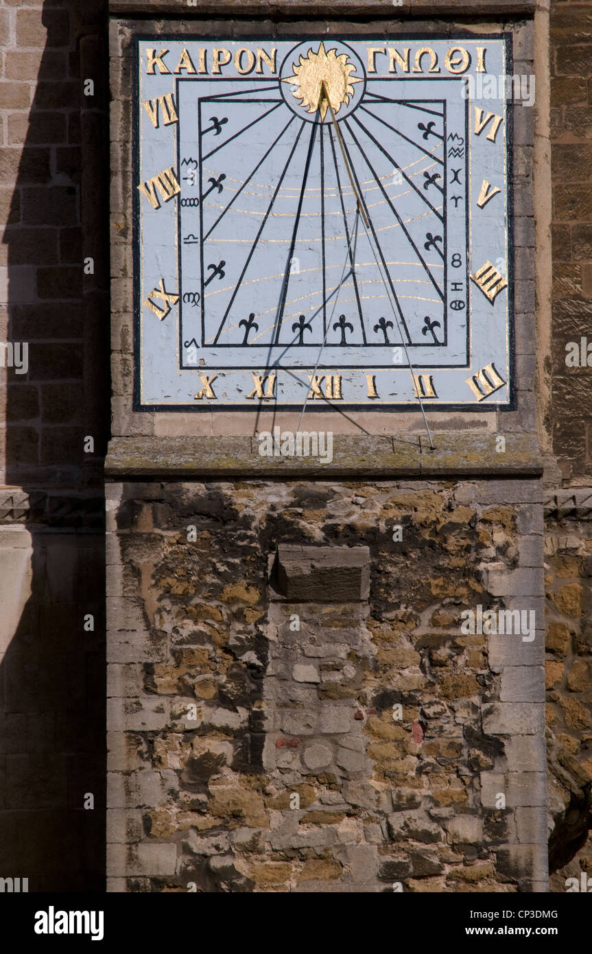 Sundial on south wall of Ely Cathedral Cambridgeshire England with guilded roman numerals and motto reading KAIPON - Stock Image