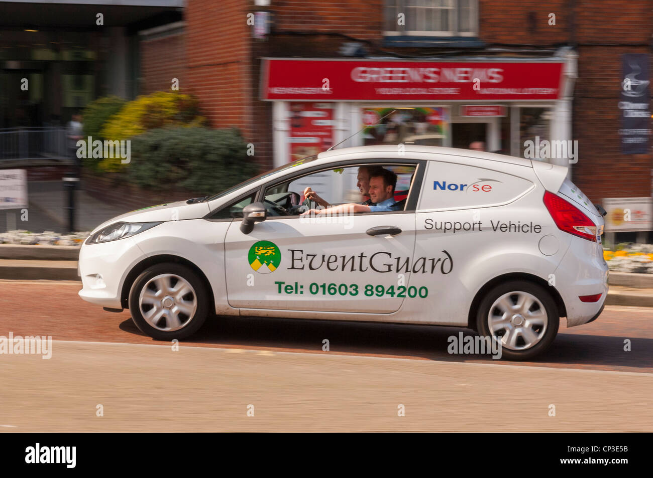 A Norse support vehicle Event Guard driving through the city showing movement in Norwich , Norfolk , England , Britain - Stock Image