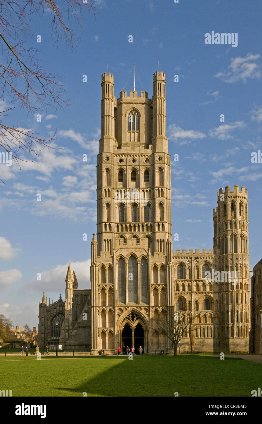 The west Tower and entrance to Ely Cathedral Cambridgeshire England with Palace Green in foreground Stock Photo