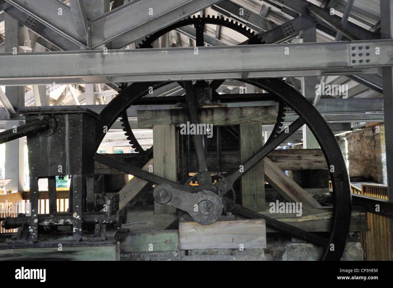 Machinery for sugar cane processing is displayed at the Dunlawton Sugar Mill Botanical Gardens in Port Orange, Florida - Stock Image