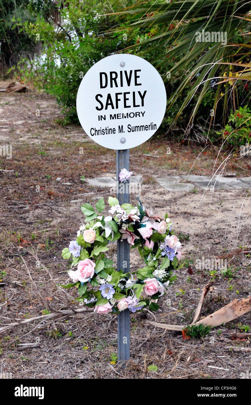 Roadside memorial in Ormond Beach, Florida, remembering Christine Summerlin and urging safe driving - Stock Image